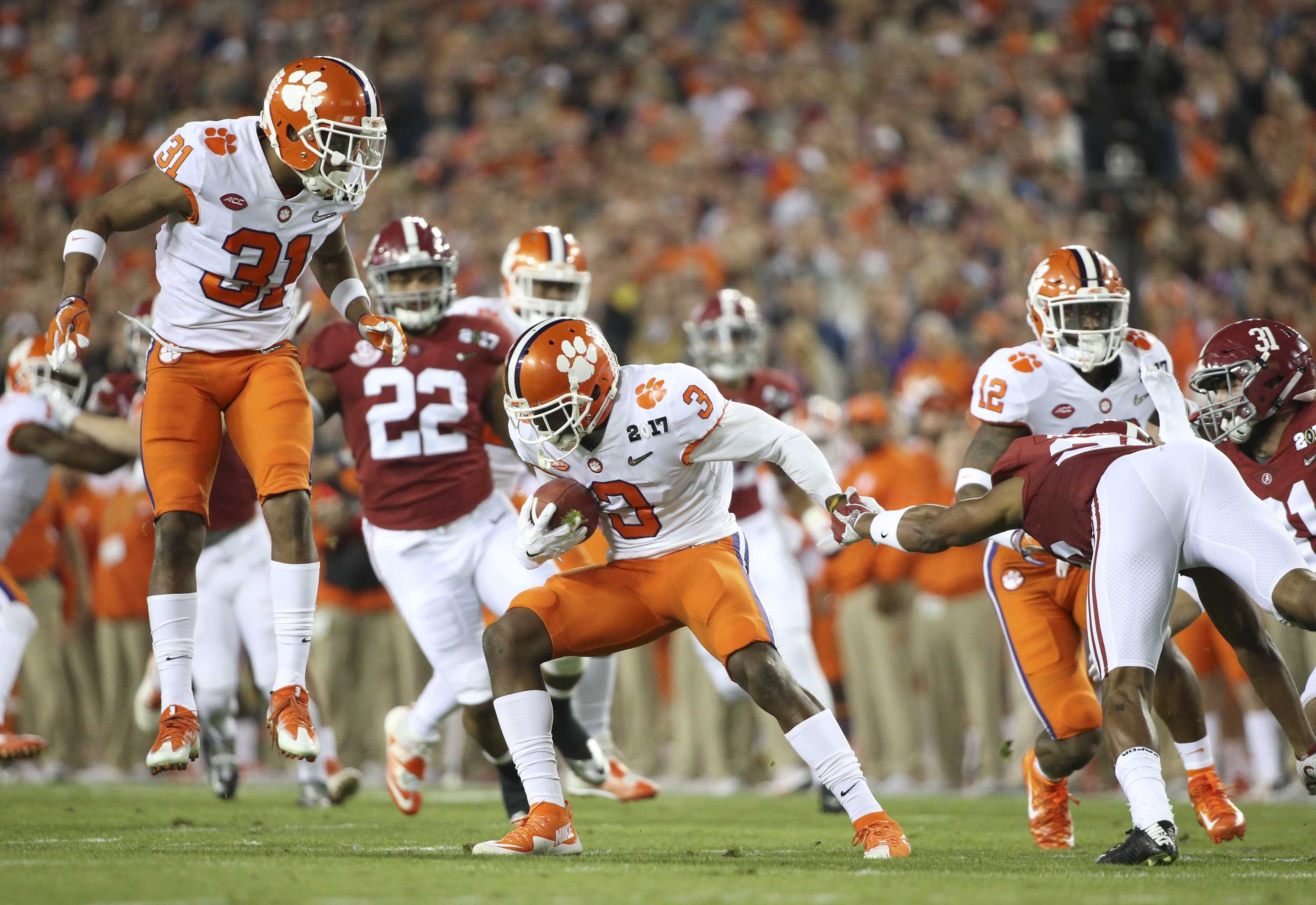 Clemson Tigers wide receiver Artavis Scott (3) runs the ball as Clemson Tigers safety Kyle Cote (32) looks on during the first quarter against the Alabama Crimson Tide during the College Football Playoff National Championship on Monday, Jan. 9, 2017 at Raymond James Stadium in Tampa, Fla. (Loren Elliott/Tampa Bay Times/TNS)