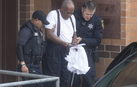 Bill Cosby is escorted by police in handcuffs as he exits the Montgomery County Correctional Facility in Norristown, Pa., on Tuesday, Sept. 26, 2018.