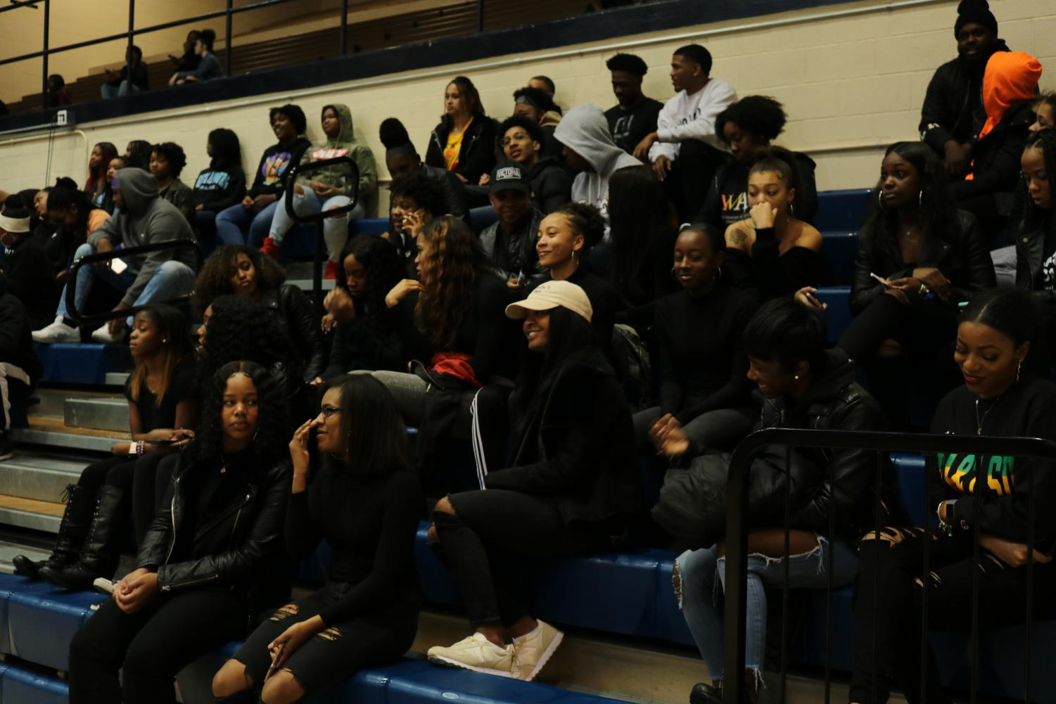 Gold squad cheerleaders, survivors and supporters sit in solidarity during the Women and Men basketball games.