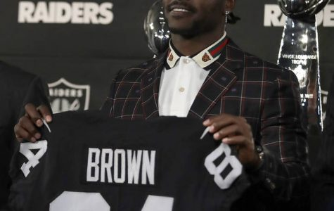 AB trades black and yellow for black and silver; joins Oakland