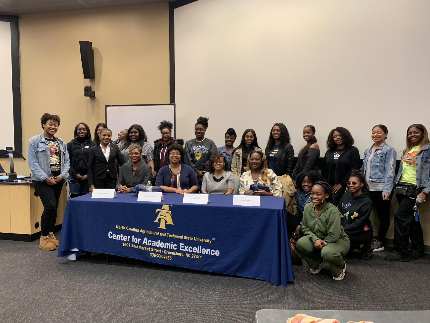 Alumnae and participants pose for a photo after the discussion.