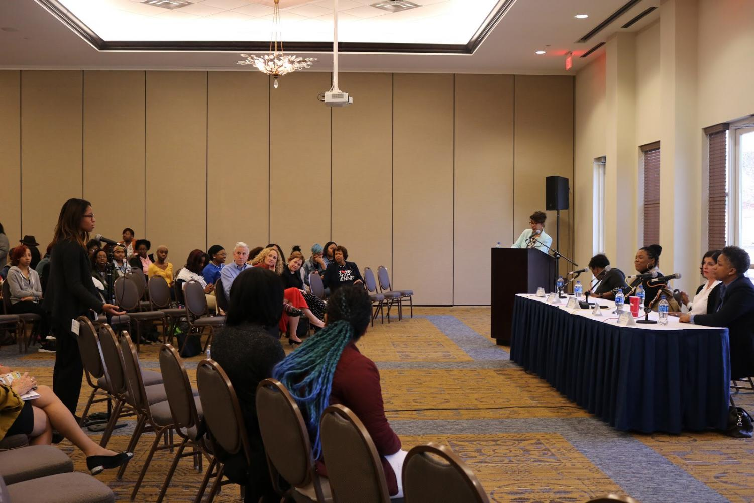 Branch speaks with panelists during the question and answer portion of the Women In Entrepreneurship panel.