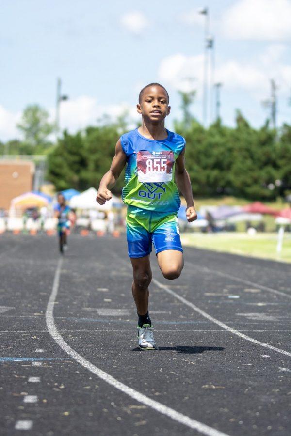 Student+athlete+crosses+the+finish+line+100m+dash.