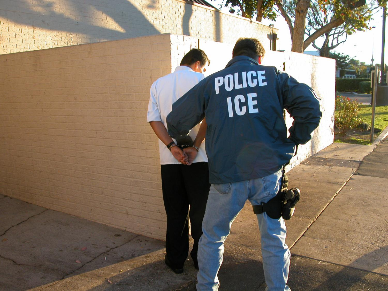 U.S. Police I.C.E. arrest a man.