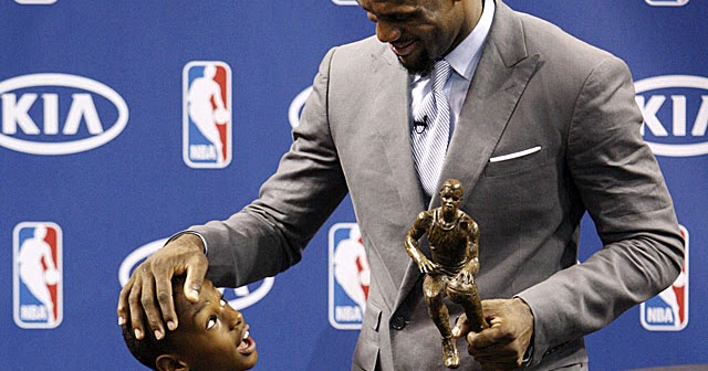 LeBron James, right, chats with his son LeBron James Jr. after having accepted the NBA MVP trophy, Saturday, May 12, 2012 in Miami. Calling the honor
