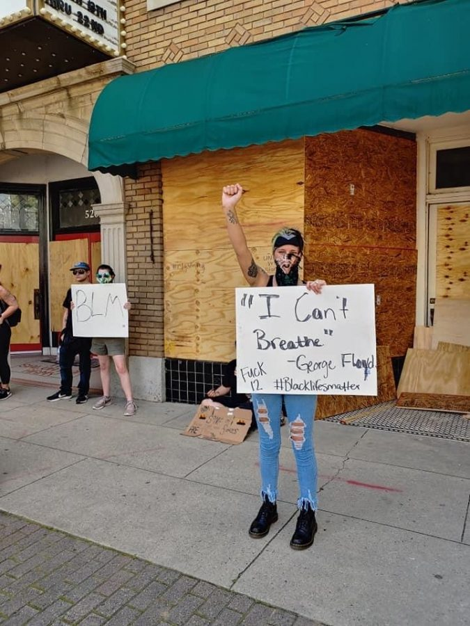 Protester raises fist in solidarity.