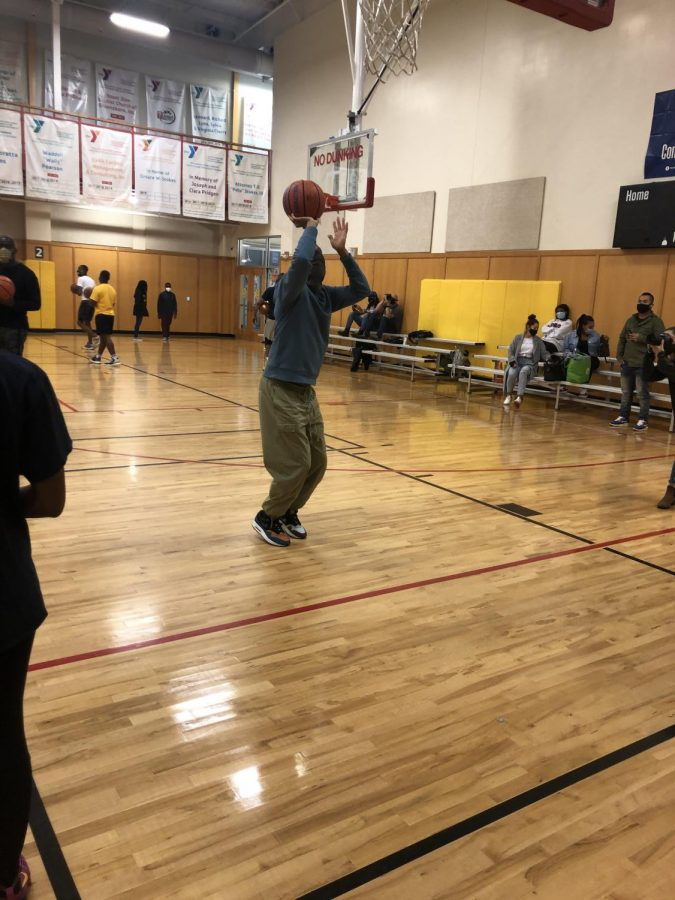 Grammy award-winning rapper and activist, Common, plays basketball with the youth and encourages the community to go out and vote.