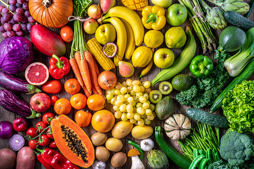 Colorful vegetables and fruits vegan food in rainbow colors arrangement full frame